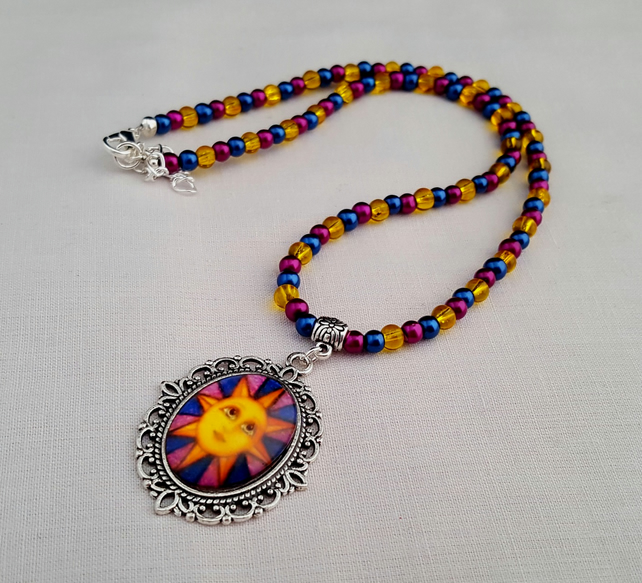 Blue, magenta and yellow sun face pendant necklace - 1001786