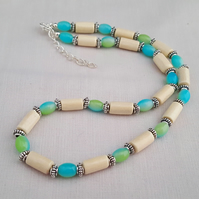 Cream wooden bead necklace with blue and green beads - 1001848