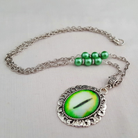 Green Dragon Eye pendant on beaded chain