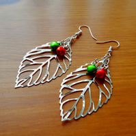 Large silver leaf earrings with red and green jingle bell berries