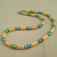 Cream wooden tube necklace with green and blue glass beads - 1002045