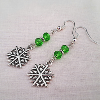 Sparkly bright green and Tibetan silver snowflake earrings
