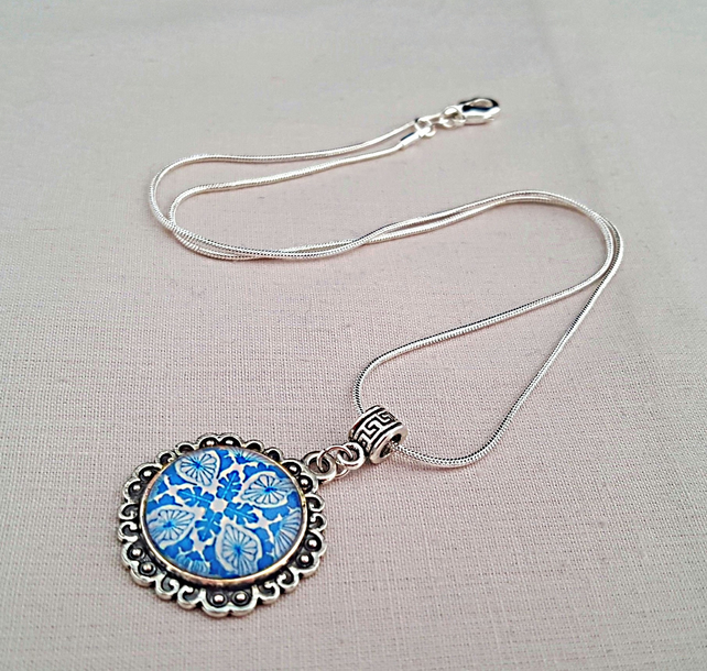 Blue and white mandala pendant necklace