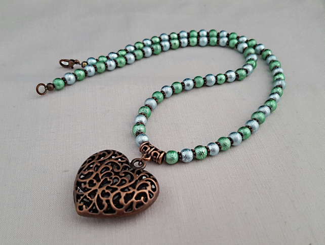 Shimmery blue and green bead necklace with copper heart pendant - 1001085