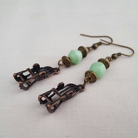 Green and bronze rocking chair earrings
