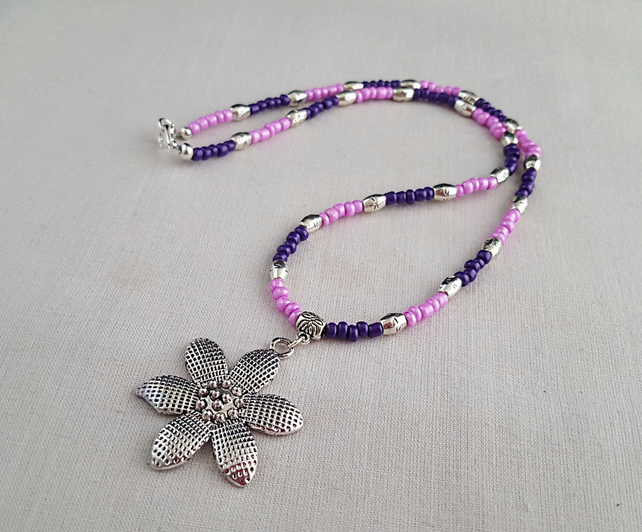 Pink and purple bead necklace with silver flower pendant - 1002091F