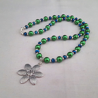 Green and blue bead necklace with silver flower pendant - 1002215F