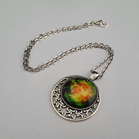 Green, yellow and orange Cosmos pendant on silver chain