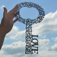 Love is the key - a unique paper cut incorporating over 100 tiny keys.