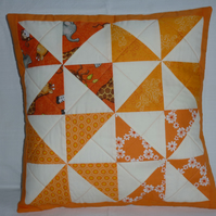 Orange Pinwheel cushion