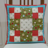 Red and green square patchwork cushion