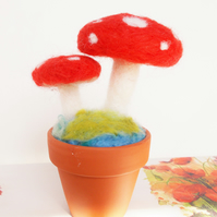 Felted toadstools in terracotta pot
