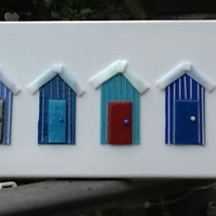 5 little blue beach huts
