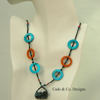Necklace; Black  & coloured feature beads with shell hoops  (N39)