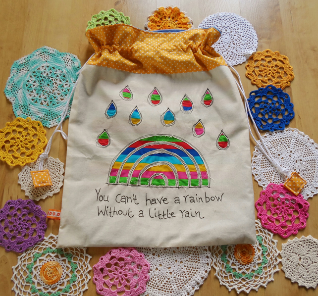 drawstring bag with appliqued rainbow