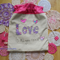 Drawstring bag with LOVE applique