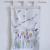 Fabric wall hanging with wild flowers design