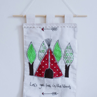 Fabric wall hanging with teepee design