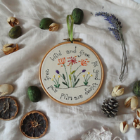 Hoop art with embroidered flowers and inspirational quote