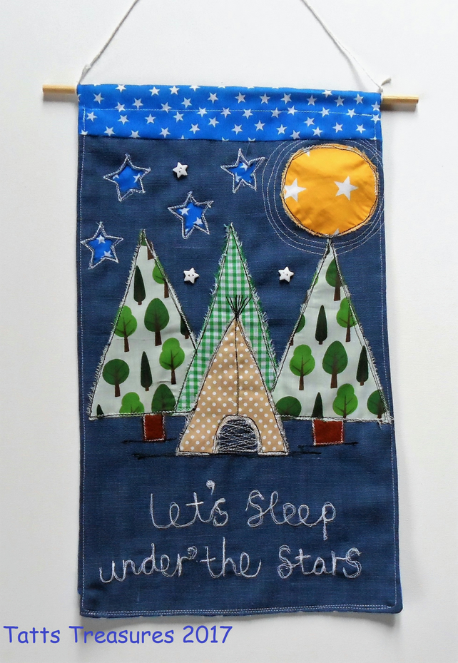 Fabric wall hanging with appliqued teepee design