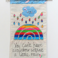 Fabric wall hanging with appliqued rainbow design