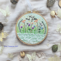 Hoop art with embroidered flowers