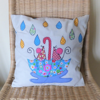Cushion with little mouse applique