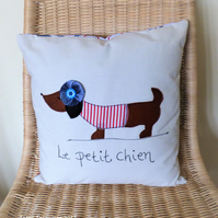 Cushion with sausage dog applique