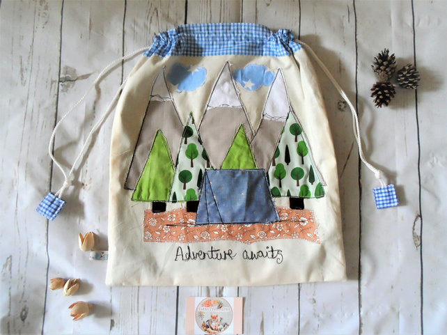Drawstring fabric bag with Camping theme applique