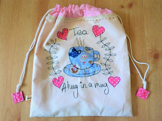 Drawstring bag with teacup applique