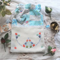 Fabric drawstring bag with vintage embroidery