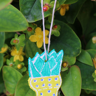 Handmade and handpainted hanging cactus ornament or gift tag in polka dot yellow