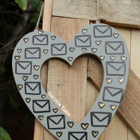 Hand drawn khaki hanging heart with love letter pattern home decor