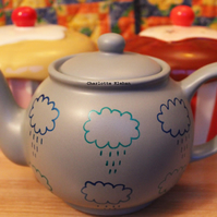 Hand drawn large grey porcelain teapot with rain clouds weather pattern tea