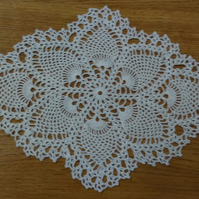 PAIR OF CLASSIC CREAM TABLE MATS, DOILIES OR CENTREPIECES - 34cm X 24cm, UNUSUAL