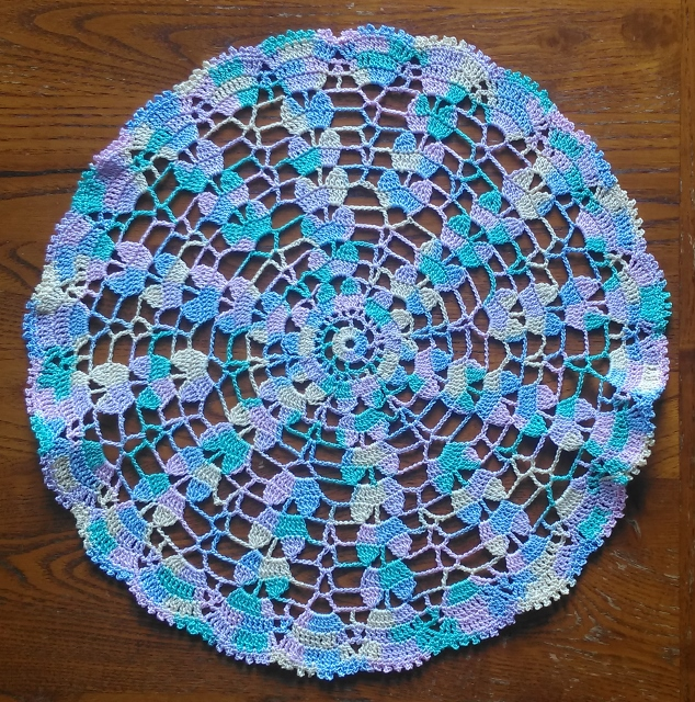 MULTICOLOURED TABLE MAT or DOILY WITH FRILLED EDGE - 28.5cm ACROSS -