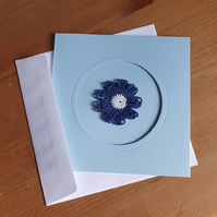 BLUE CARD, BLUE & WHITE FLOWER TO CENTRE - 13CM SQUARE - BLANK FOR YOUR MESSAGE