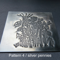 Pewter embossed coaster with antiqued satin finish & cork base.