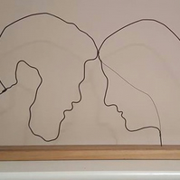 Personalised wire profiles mounted on wood