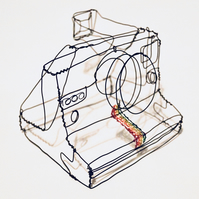 Wire Sculpture of a vintage Polaroid 1000 Camera