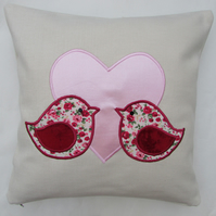 Lovebirds cushion in cream with pink appliqued heart and lovebirds