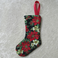 Small Christmas stocking tree decoration in black and floral print fabric