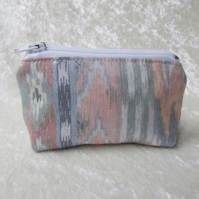 Small purse with abstract pastel print pattern