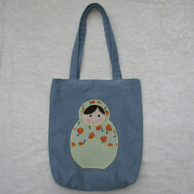 Russian Doll appliqued tote bag in blue and yellow