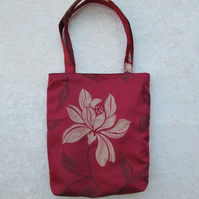 Dark red tote bag with large gold flower