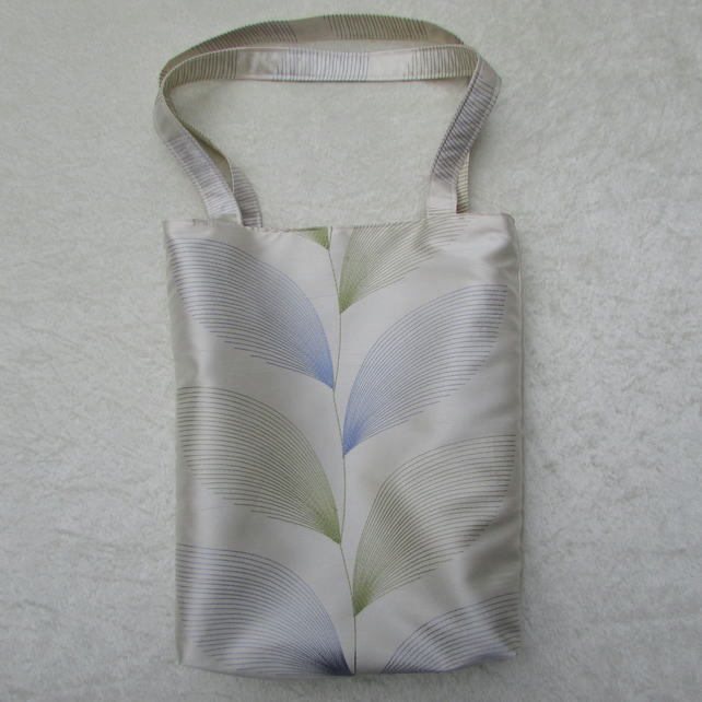 Ivory satin tote bag with blue and green leaf pattern