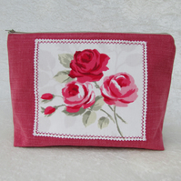 Roses toiletry bag in coral pink