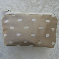 Small purse in gold fabric with cream textured spot pattern
