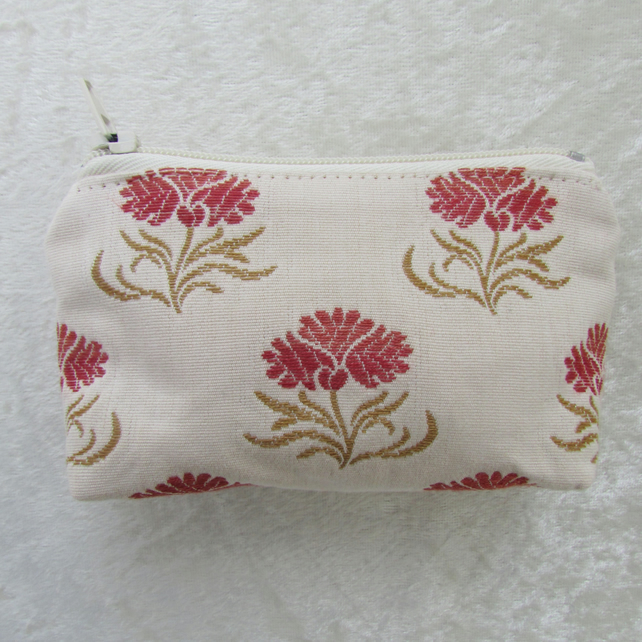 Small purse in cream and red floral fabric