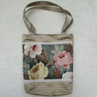 Gold satin tote bag with decorative floral panel